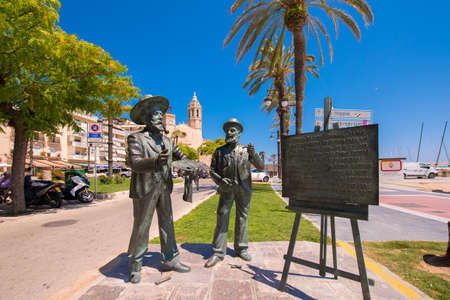 SITGES, CATALUNYA, SPAIN - JUNE 20, 2017: Sculptures of artists on the waterfront. Copy space for text Editorial