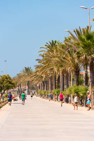 SITGES, CATALUNYA, SPAIN - JUNE 20, 2017: View of the embankment. Copy space for text. Vertical