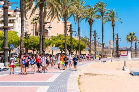 SITGES, CATALUNYA, SPAIN - JUNE 20, 2017: People walk along the embankment Editorial