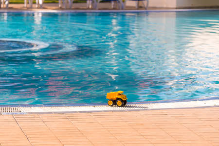 Yellow toy car on the edge of the pool, Varadero, Matanzas, Cuba. Copy space for text Editorial