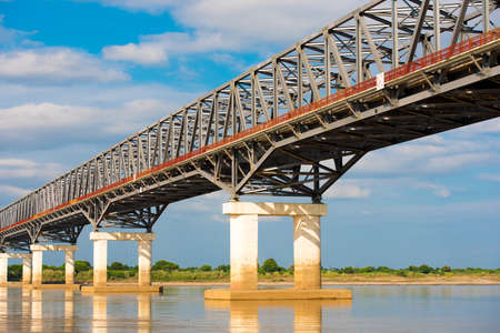 Steel bridge over the Irrawaddy river in Mandalay, Myanmar, Burma. Copy space for text