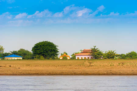 colorfully: Buildings on the banks of the river Irrawaddy, Mandalay, Myanmar, Burma. Copy space for text