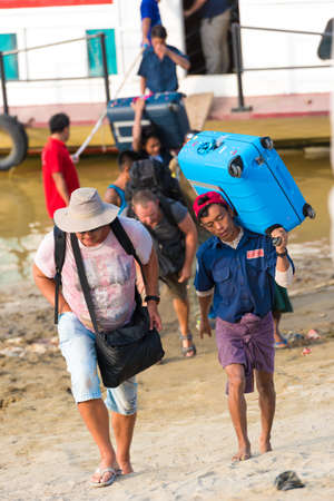 BAGAN, MIANMAR - DECEMBER 1, 2016: Tourists go ashore, Burma. Vertical