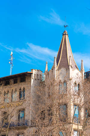 catalunya: BARCELONA, SPAIN - FEBRUARY 16, 2017: Beautiful building in the city center. �oncept with a blue background. Copy space for text. Vertical
