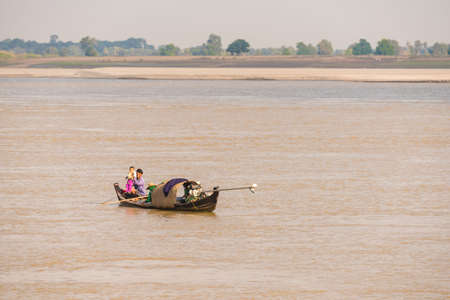 BAGAN, MIANMAR - DECEMBER 1, 2016: People in a boat on the river Irrawaddy, Burma. Copy space for text Editorial