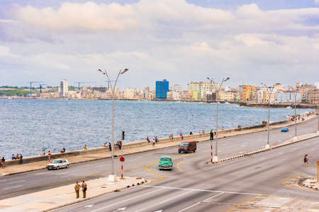 CUBA, HAVANA - MAY 5, 2017: Cars drive along the Malecon waterfront. Copy space for text