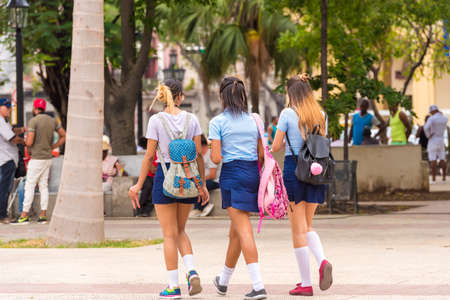 CUBA, HAVANA - MAY 5, 2017: Schoolgirls in uniform on Havana street.
