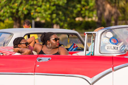 CUBA, HAVANA - MAY 5, 2017: African women sit in an American retro cabriolet. Close-up