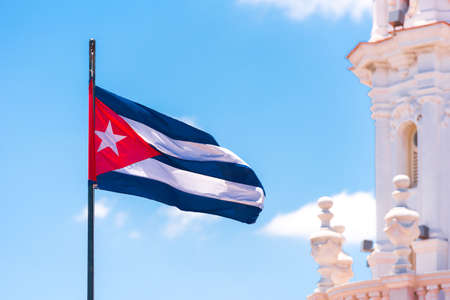 Cuban flag against the blue sky. Copy space.