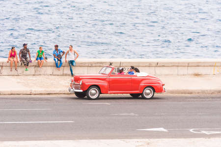 CUBA, HAVANA - MAY 5, 2017: American red retro cabriolet on city street. �opy space for text