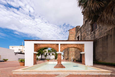 View of the arch and fountain, Santo Domingo, Dominican Republic. Copy space for text