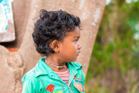 PUTTAPARTHI, ANDHRA PRADESH, INDIA - JULY 9, 2017: Portrait of  Indian cute girl on the street. Close-up Editorial