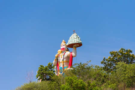Hill View Stadium - Hanuman Statue, Puttaparthi, Andhra Pradesh, India. Copy space for text Stock Photo