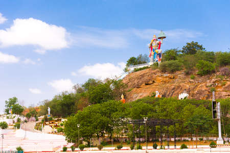 PUTTAPARTHI, ANDHRA PRADESH, INDIA - JULY 9, 2017: Hill View Stadium - Hanuman Statue. Copy space for text