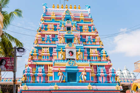 PUTTAPARTHI, ANDHRA PRADESH, INDIA - JULY 9, 2017: Gopuram - front-arch entrance to a temple in Dravidian style. Copy space for text