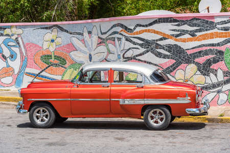 VINALES, CUBA - MAY 13, 2017: American red retro car. Copy space for text Stok Fotoğraf