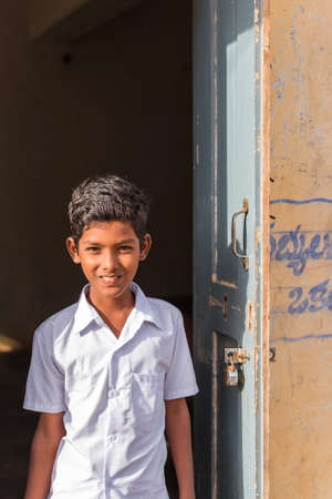 PUTTAPARTHI, ANDHRA PRADESH, INDIA - JULY 9, 2017: Portrait of Indian boy. Copy space for text. Vertical