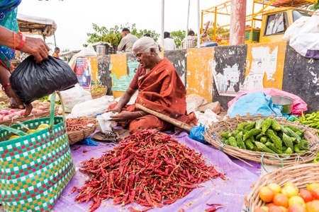 PUTTAPARTHI, ANDHRA PRADESH - INDIA - JULY 22, 2017: Woman sells vegetables at the local market. Close-up Editorial
