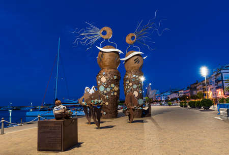 CAMBRILS, SPAIN - SEPTEMBER 16, 2017: View of the embankment of the city and the modern sculpture Editorial