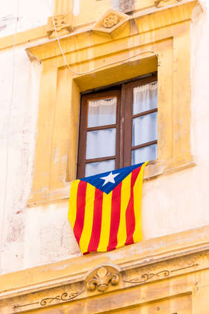 first nations: The flag Estelada on the facade of the building. Before the referendum on independence, Tarragona, Catalonia, Spain. Close-up. Vertical Stock Photo
