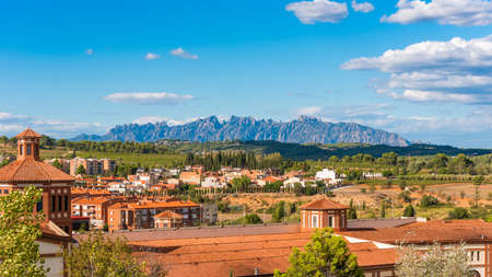 BARCELONA, CATALONIA, SPAIN - SEPTEMBER 11, 2017: View of the building in the valley of the mountains of Montserrat. Copy space for text