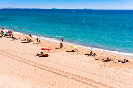 MIAMI PLATJA, SPAIN - SEPTEMBER 13, 2017: View of the sandy beach Mont-roig del Camp. Copy space for text