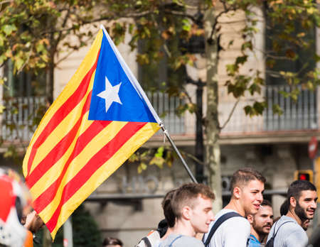 first nations: BARCELONA, SPAIN - OCTOBER 3, 2017: Demonstrators bearing catalan flag during protests for independence in Barcelona. Close-up