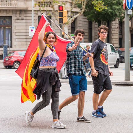 first nations: BARCELONA, SPAIN - OCTOBER 3, 2017: Demonstrators bearing catalan flags during protests for independence in Barcelona. Close-up