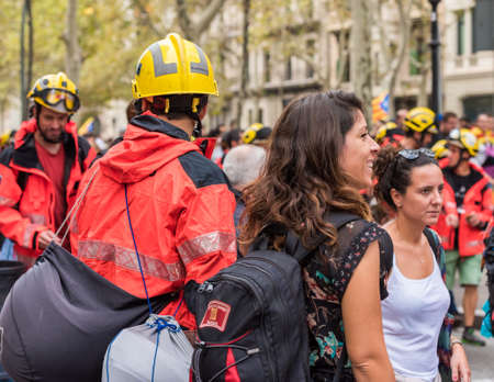first nations: BARCELONA, SPAIN - OCTOBER 3, 2017: Workers in helmets at a demonstration in Barcelona. Close-up