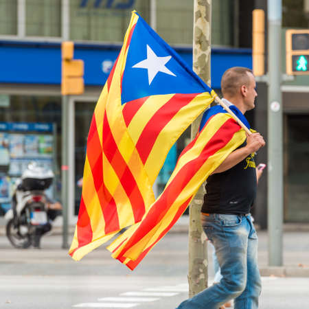 BARCELONA, SPAIN - OCTOBER 3, 2017: A man with a Catalan flag at a demonstration in Barcelona. Close-up