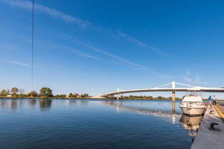 ebro: Sant Jaume dEnveja new bridge Lo Passador over Ebro river Ebro Delta, Tarragona, Catalonia, Spain. Copy space for text
