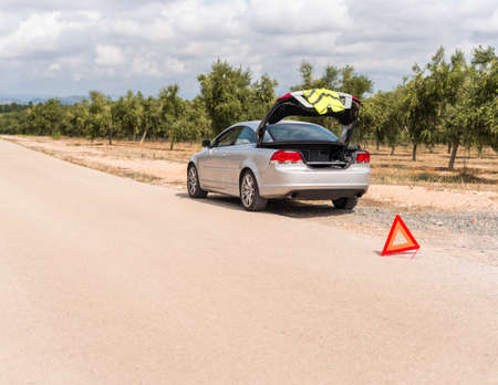 The Spanish landscape. The car broke down on the road. Copy space for text. Stock Photo