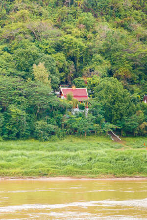 View of the Nam Khan river, Louangphabang, Laos. Copy space for text. Vertical