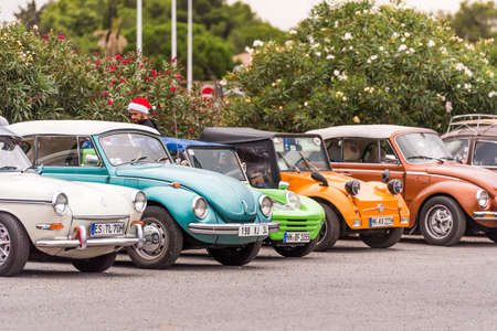 AGDE, FRANCE - SEPTEMBER 9, 2017: Group of Volkswagen Beetles exhibited during the 16th Volkswagen Meeting of Cap dAgde. Copy space for text Editorial
