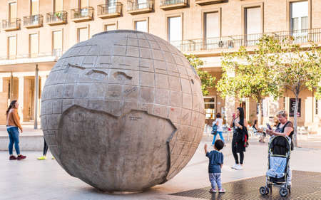 entertaining area: SARAGOSSA, SPAIN - SEPTEMBER 27, 2017: Enormous globe on an area Plaza del Pilar in a historical center. Copy space for text