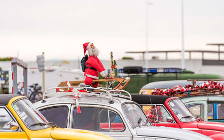 Santa Claus at the exhibition of retro cars, Agde, France. Copy space for text Stock Photo