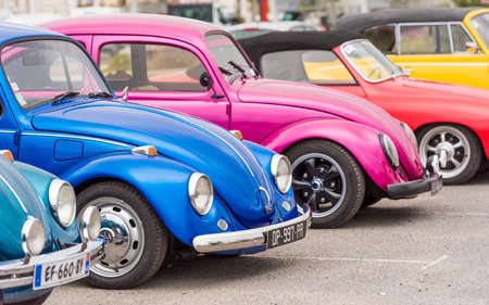 AGDE, FRANCE - SEPTEMBER 9, 2017: Group of Volkswagen Beetles exhibited during the 16th Volkswagen Meeting of Cap dAgde. Close-up