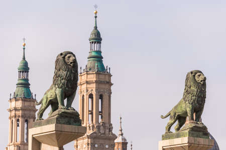 Sculptures of lions on the background of the Cathedral-Basilica of Our Lady of the Pillar, Zaragoza, Spain. Close-up