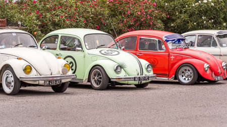 AGDE, FRANCE - SEPTEMBER 9, 2017: Group of Volkswagen Beetles exhibited during the 16th Volkswagen Meeting of Cap d'Agde. Copy space for text