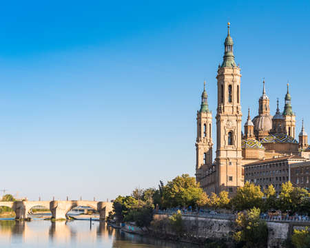 The Cathedral-Basilica of Our Lady of Pillar - a roman catholic church, Zaragoza, Spain. Copy space for text 스톡 콘텐츠