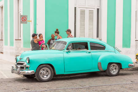 CUBA, HAVANA - MAY 5, 2017: A blue American retro car on a city street. Copy space for text