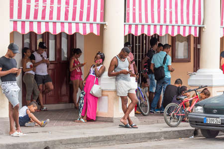 CUBA, HAVANA - MAY 5, 2017: Group of people near the building. Copy space for text