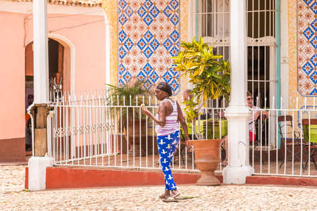 TRINIDAD, CUBA - MAY 16, 2017: Cuban elderly woman on a city street. Copy space for text.