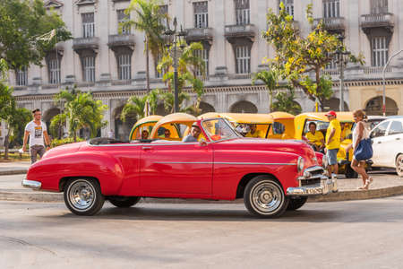 CUBA, HAVANA - MAY 5, 2017: American red retro cabriolet on city street. Copy space for text