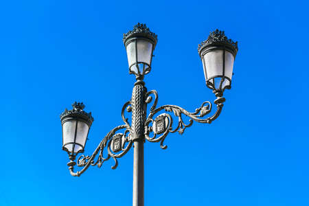 Classical old lamp against the blue sky, Madrid, Spain. Copy space for text