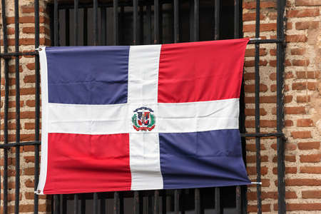 Dominican flag on the facade of the building, Santo Domingo, Dominican Republic. Close-up