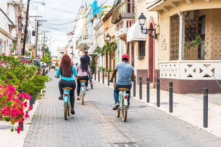 SANTO DOMINGO, DOMINICAN REPUBLIC - AUGUST 8, 2017: People on bicycles on a city street. Copy space for text Imagens