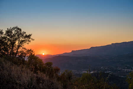 View of the mountain landscape at sunset in Siurana de Prades, Tarragona, Spain. Copy space for text Stock Photo