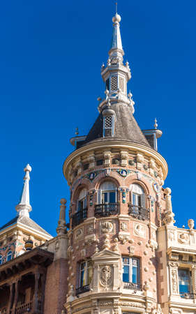 Beautiful historical building of old architecture in the city center, Madrid, Spain. Copy space for text. Vertical Stock Photo