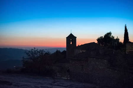 View of the Romanesque church of Santa Maria de Siurana at sunset in Siurana de Prades, Tarragona, Spain. Copy space for text Stock Photo